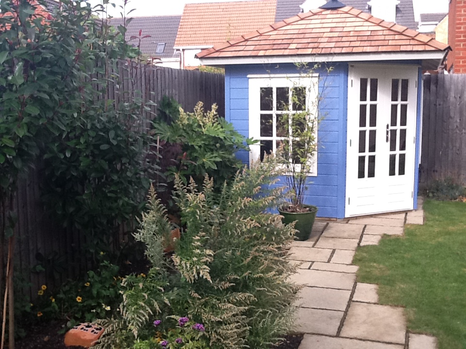 This Customeru0027s Corner Summerhouse Sits Neatly Against The Fence And  Provides A Lovely Garden Feature As Well As Being Space Saving.