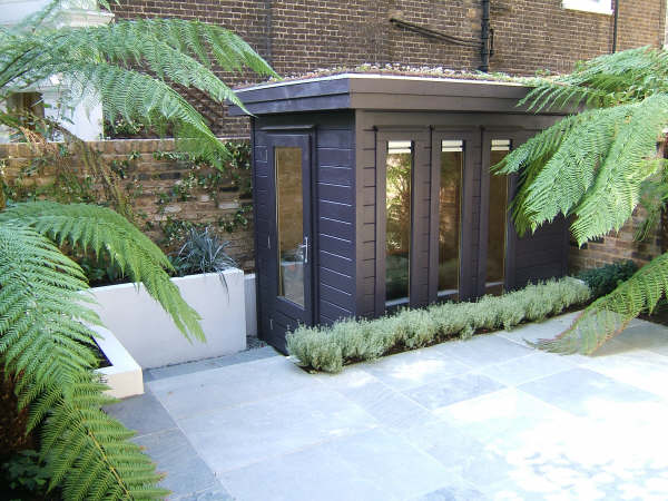 small contemporary garden office with green roof